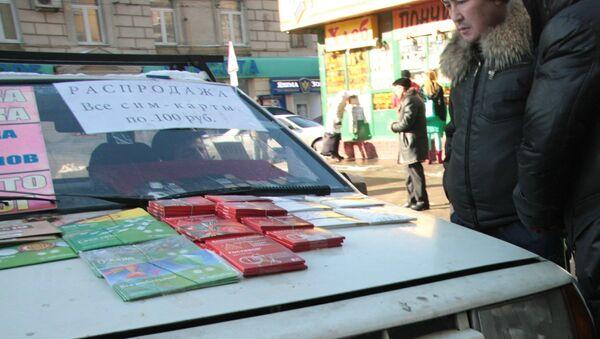 Продажа контрактов на подключение к сотовым операторам, архивное фото - Sputnik Таджикистан
