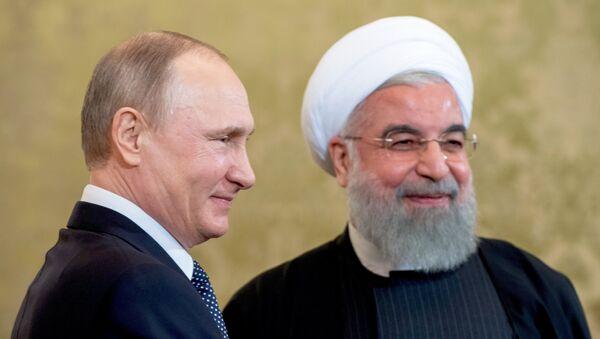 Президент РФ В. Путин встретился с президентом Ирана Х. Рухани - Sputnik Тоҷикистон