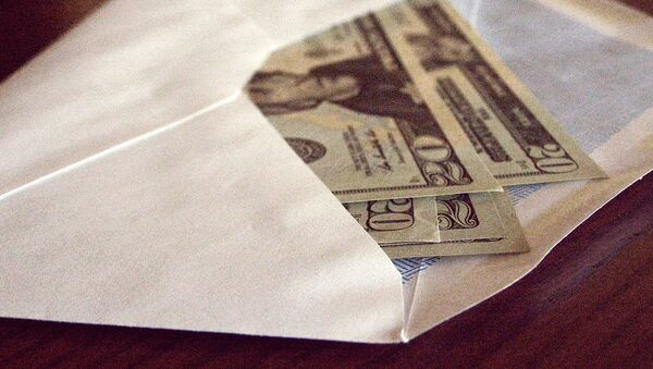 Доллары в конверте, архивное фото - Sputnik Таджикистан