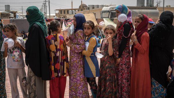 Женщины и дети в Ираке, архивное фото - Sputnik Таджикистан