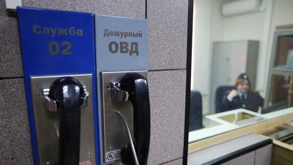 Телефон дежурной части ОВД в Москве, архивное фото - Sputnik Таджикистан