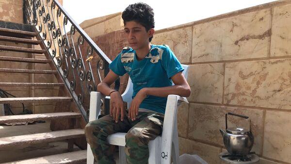 Подросток Мохамед Ахмад, переживший со своей семьей осаду Дейр-эз-Зор - Sputnik Таджикистан