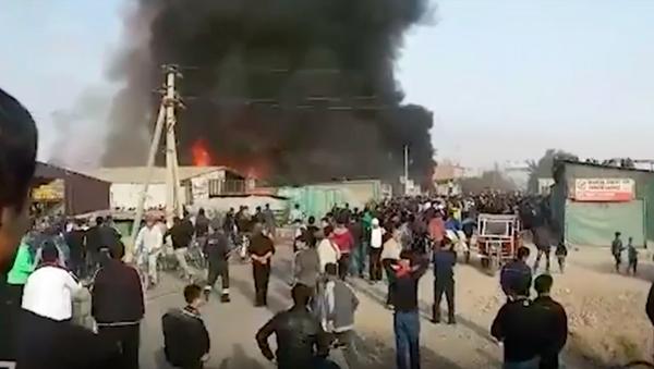 Пожар на рынке в Курган-Тюбе - Sputnik Тоҷикистон