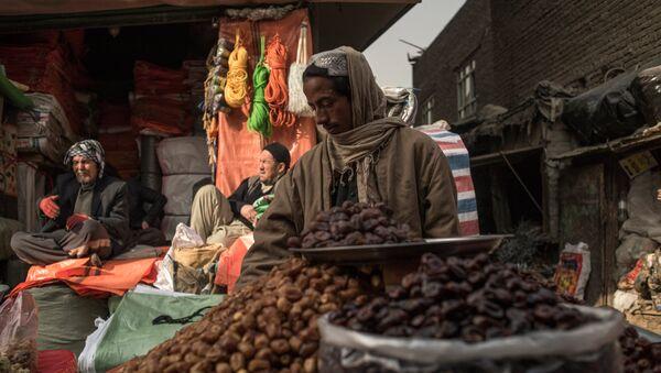 Продавец фиников на рынке в Кабуле - Sputnik Таджикистан