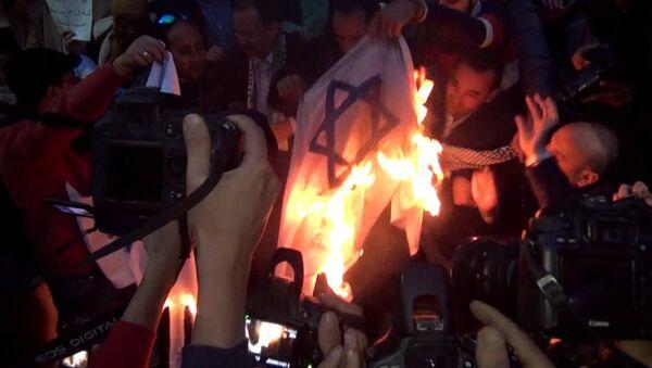 Демонстрации мусульман в мире против признания США Иерусалима столицей Израиля - Sputnik Тоҷикистон