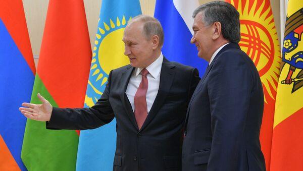 Президент РФ Владимир Путин и президент Узбекистана Шавкат Мирзиёев - Sputnik Тоҷикистон