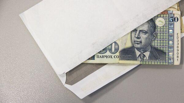 Конверт с деньгами, архивное фото - Sputnik Тоҷикистон