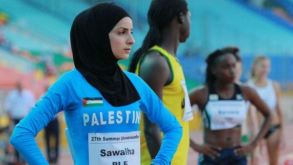 Палестинка Воруд Савалха во время соревнований среди женщин по легкой атлетике на Универсиаде в Казани - Sputnik Тоҷикистон