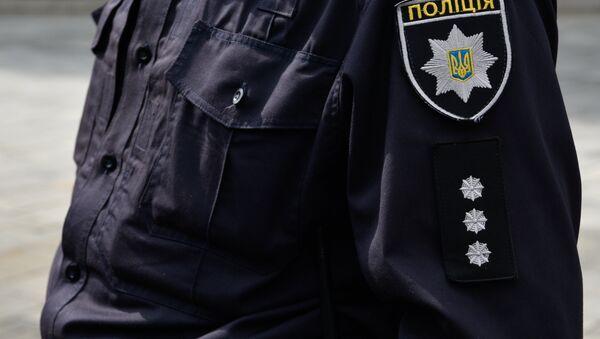 Сотрудник Украинской полиции, архивное фото - Sputnik Таджикистан