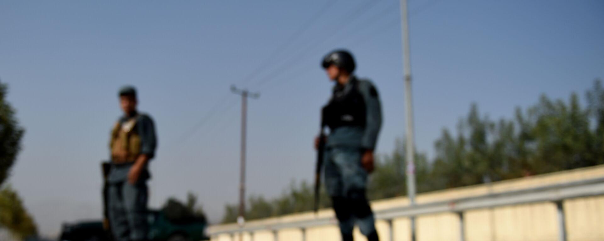 Афганский полицейский на месте взрыва, архивное фото - Sputnik Таджикистан, 1920, 26.08.2021