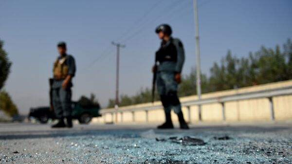 Афганский полицейский на месте взрыва, архивное фото - Sputnik Таджикистан