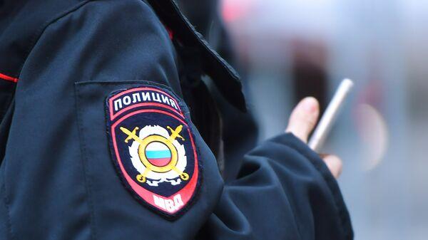 Эмблема на форме сотрудника полиции, архивное фото - Sputnik Тоҷикистон