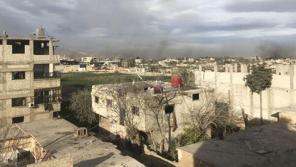 Дым, возникший в результате ударов сирийской армии по позициям Джебхат ан-Нусра (организация запрещена в РФ), в Восточной Гуте в пригороде Дамаска - Sputnik Таджикистан
