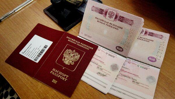 Оформление и выдача биометрических заграничных паспортов - Sputnik Тоҷикистон
