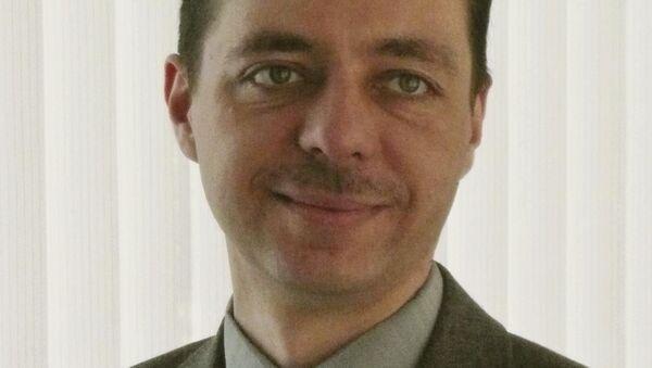 Ведущий научный сотрудник Института Европы РАН Николай Кавешников - Sputnik Таджикистан