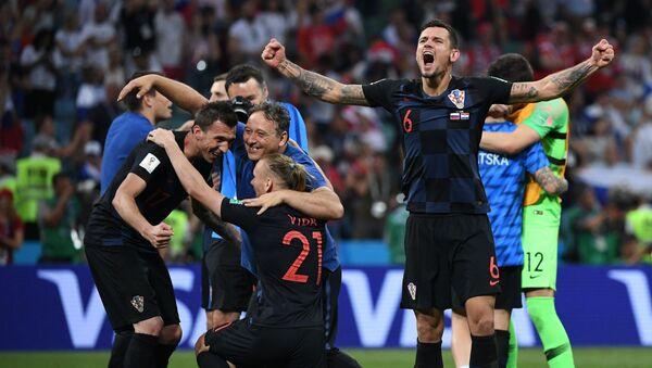 Игроки сборной Хорватии радуются победе, архивное фото - Sputnik Таджикистан
