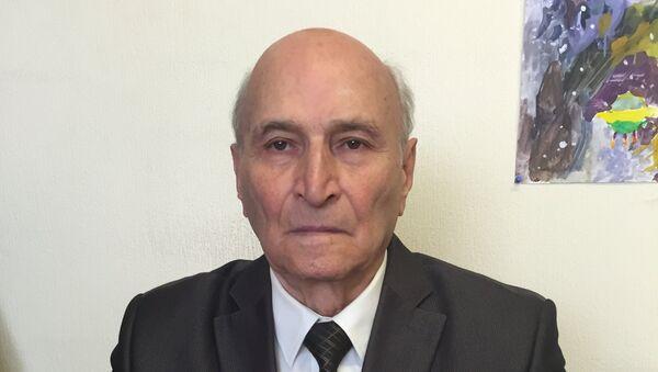 Профессор кафедры использования водной энергии МГСУ Валентин Берлин - Sputnik Таджикистан