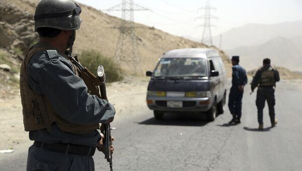 Офицер полиции в Афганистане, архивное фото - Sputnik Таджикистан