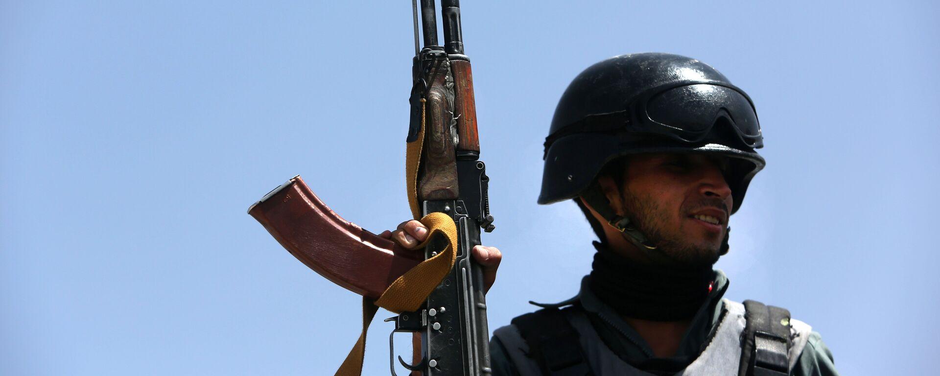 Полицейский в Афганистане, архивное фото - Sputnik Тоҷикистон, 1920, 31.03.2021