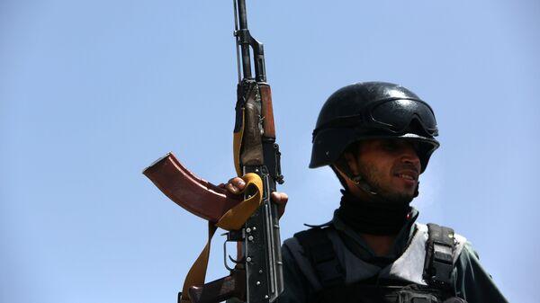 Полицейский в Афганистане, архивное фото - Sputnik Тоҷикистон
