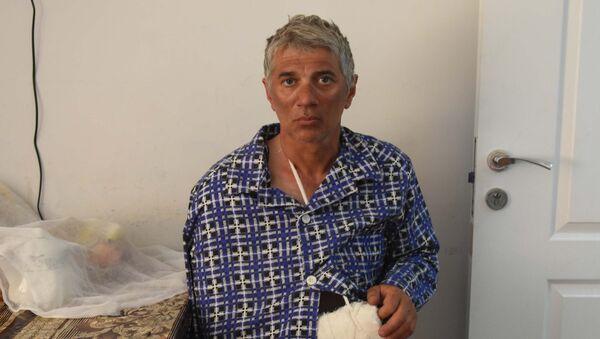 Пострадавший в Таджикистане альпинист Дмитрий Кумшаев в больнице Истиклол - Sputnik Таджикистан