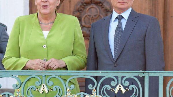 Рабочий визит президента РФ В. Путина в Германию - Sputnik Тоҷикистон