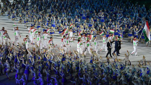 Сборная Таджикистана на церемонии открытия летних Азиатских игр 2018 - Sputnik Таджикистан