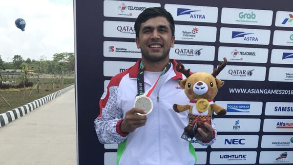 Шахриёр Даминов, таджикский спортсмен получил серебро на Азиада-2018 - Sputnik Тоҷикистон