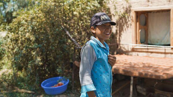 Мальчик смеется, архивное фото - Sputnik Таджикистан
