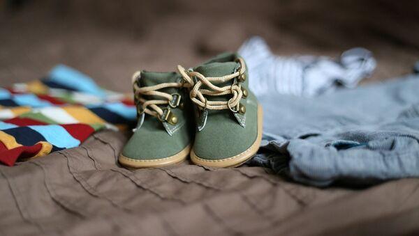 Туфли для малыша, архивное фото - Sputnik Таджикистан