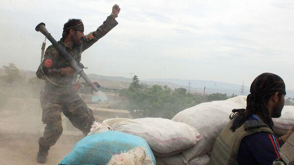 Военнослужащие афганской армии во время столкновения с талибами*, архивное фото - Sputnik Таджикистан