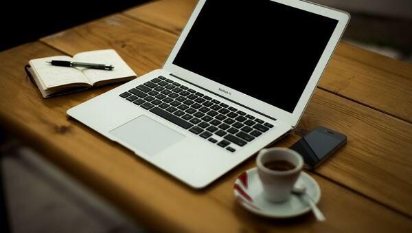 Ноутбук, архивное фото - Sputnik Таджикистан