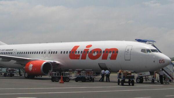 Самолет авиакомпании Lion Боинг 737-900ER , архивное фото - Sputnik Таджикистан
