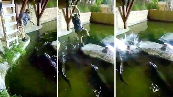 Американец упал с тарзанки в водоем, кишащий крокодилами. Видео - Sputnik Таджикистан