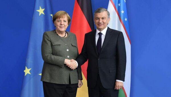 Ангела Меркель и Шавкат Мирзиёев - Sputnik Таджикистан