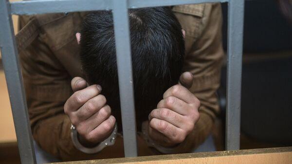 Задержанный преступник, архивное фото  - Sputnik Тоҷикистон