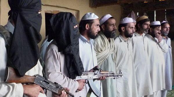 Вооруженные сторонники движения ИГИЛ, архивное фото - Sputnik Тоҷикистон
