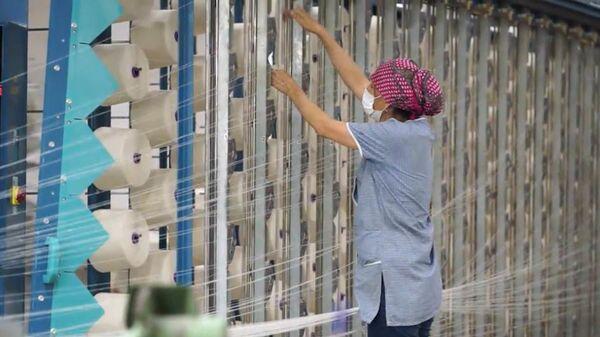 На фабрике по производству тканей, архивное фото - Sputnik Таджикистан