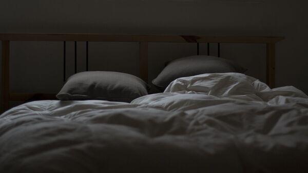 Кровать в номере, архивное фото - Sputnik Тоҷикистон