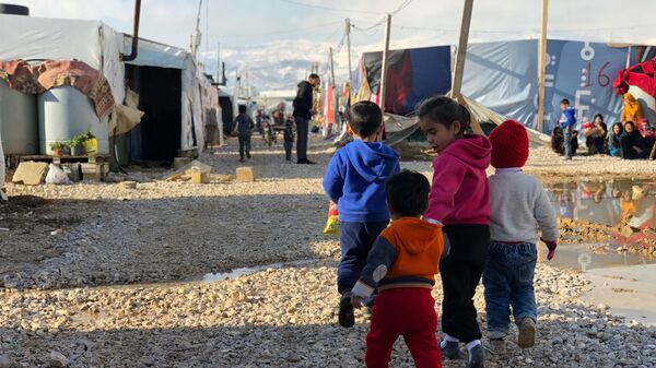 Пострадавший от удара стихии лагерь беженцев Абу-Мазен в поселении Барэльяс в долине Бекаа - Sputnik Тоҷикистон