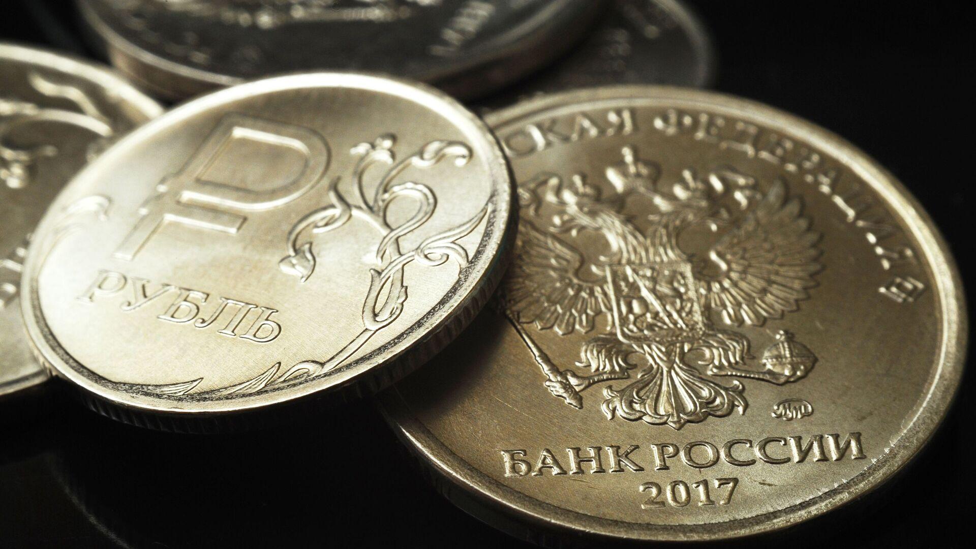 Монеты номиналом один рубль - Sputnik Таджикистан, 1920, 12.10.2021