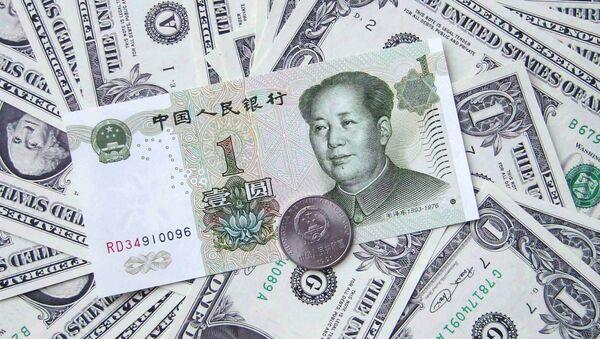 Денежные купюры. Доллары США. Китайская банкнота, архивное фото - Sputnik Таджикистан