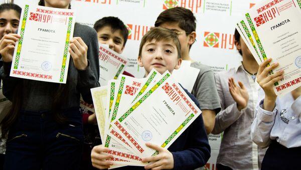 Культурный центр НУР провел школьную олимпиаду для школьников-таджиков - Sputnik Таджикистан