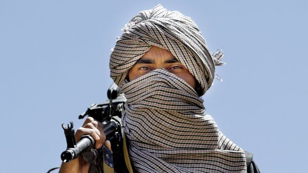 Член террористической организации Талибан в Афганистане - Sputnik Тоҷикистон