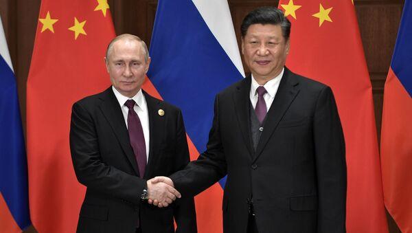 Президент РФ В. Путина и председатель КНР Си Цзиньпин - Sputnik Таджикистан