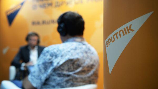 Логотип международного информационного агентства и радио Sputnik - Sputnik Таджикистан