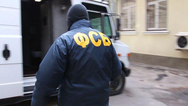 Сотрудник Федеральной службы безопасности - Sputnik Тоҷикистон