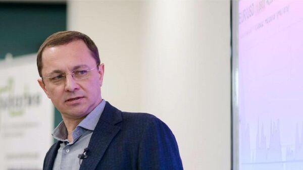 Ведущий аналитик QBF Олег Богданов - Sputnik Тоҷикистон