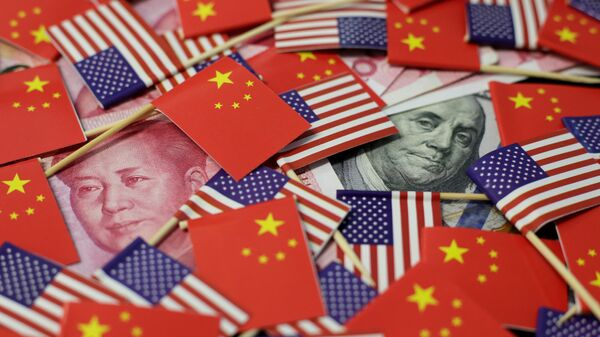 Американский доллар и китайский юань - Sputnik Таджикистан
