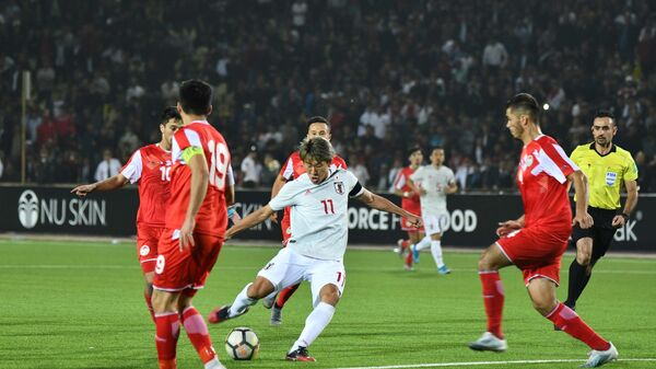 Отборочный матч между сборными Таджикистана и Японии на чемпионат мира по футболу 2022 - Sputnik Таджикистан